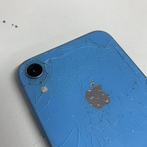 Image of an iPhone XR with a cracked backglass