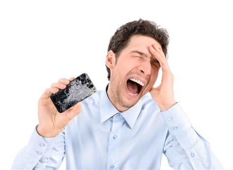 Man with sad face holding broken phone